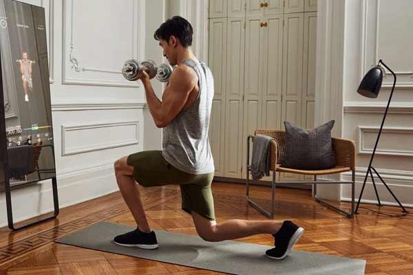 fente avec haltère pour se muscles les jambes à la maison